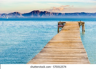 Beautiful scenery with jetty at the seaside of Alcudia beach Platja de Muro, Spain Majorca, Mediterranean Sea.