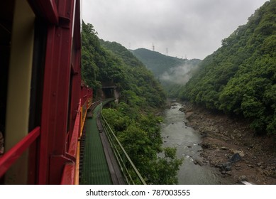Beautiful scenery of the Katsura river seen from the red wagons of the Sagano Scenic Railway, Kyoto, Japan