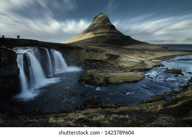 Beautiful scenery of Kirkjufell mountain and Kirkjufellfoss waterfall in Iceland is famous natural landmark and very popular for photographers and tourists. Attractions and travel concept
