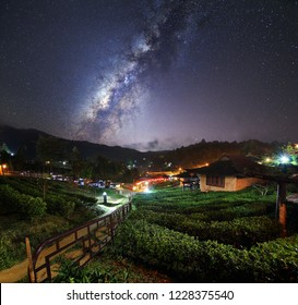 Beautiful scenery of the milky way on night sky at Chinese village among Tea Plantation at Ban Rak Thai , Mae Hong Son in Thailand. Long exposure shooting and high iso used make this photo have noise