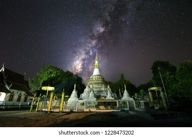 Beautiful scenery of the milky way on night sky at white pagoda in Luang temple,(Wat Luang) Pai District,Mae Hong Son in Thailand.Long exposure shooting and high iso used make this photo have noise