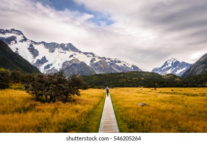 Beautiful Scenery with Narrow Boardwalk in Aoraki Mount Cook National Park, New Zealand. Backpacker go into the mountains.