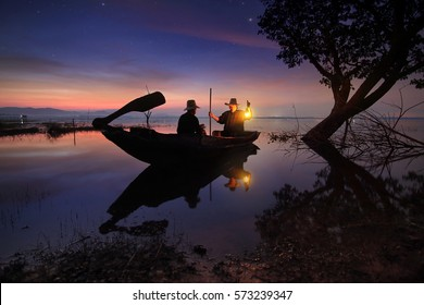 Beautiful scenery of nature and livelihoods of fishermen who are prepare boating fishing in morning time before sunrise at Bang Pra Reservoir , Chonburi province in Thailand