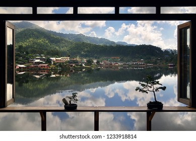 Beautiful scenery of nature with water reflection outside the window at Lee wine ruk thai Lake, Mae Hong Son in Thailand. Freedom and natural Concept
