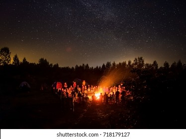 beautiful scenery of night vision. a bonfire around people, the concept of recreation