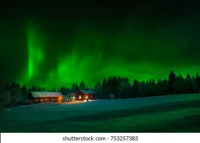 Beautiful scenery of nightscape  with northern lights in Norway with emerald green light