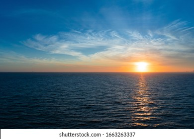 A beautiful scenery of an open sea under a blue sky at sunset - perfect for wallpapers