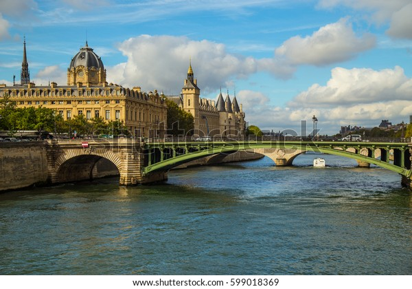 Beautiful scenery in Paris on the banks of the Seine. Warm spring day in Paris.  Beautiful Parisian bridges.  French architecture