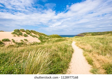 Beautiful scenery of Pembrokeshire coastline, sand dunes in Fresh Water West, South Wales, Uk in summer.Scenic landscape of british coast.Fantastic. weather.Blue sky with few clouds over horizon.