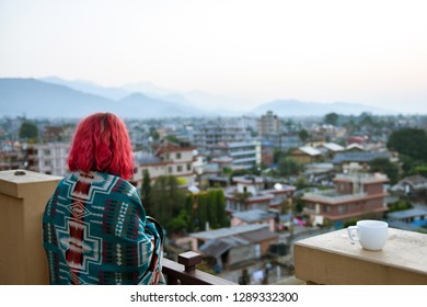 Beautiful scenery in Pokhara city with young woman watching the sunset. Asian, Nepal
