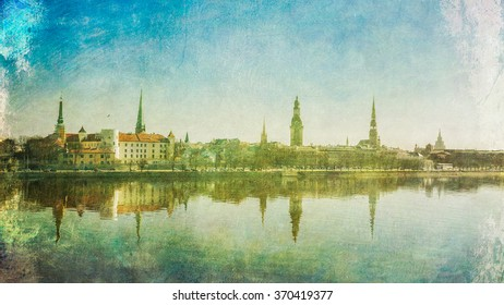 Beautiful scenery of Riga center with reflection in Daugava, vintage postcard style