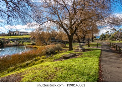Beautiful scenery of riverside footpath on a sunny winter day. Riverbank of Elizabeth River at Campbell Town. Tasmania, Australia