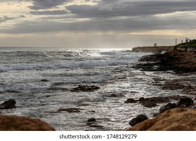 Beautiful scenery with rocky coastline and Mediterranean sea at sunset in one of the most amazing places in Cyprus. The sun bounces off the sea surface and creates interesting effects