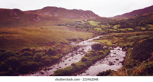 Beautiful scenery with rocky stream in County Kerry - vintage effect. Green landscape along the Ring of Kerry - retro photo. Ireland. Wide photo for web page slider.