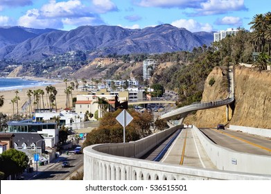 Beautiful scenery of the Santa Monica gulf and mountains over renewed Pacific Highway descent. California.