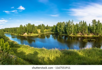 Beautiful scenery with a small lake on a sunny summer day, Russia.