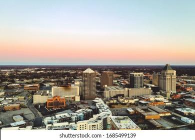 Beautiful scenery of sunset in Greensboro, North Carolina skyline with an orange sky in the background