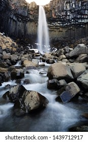 Beautiful scenery of Svartifoss in Iceland. Svartifoss waterfall or Black Waterfall is the famous natural landmark and tourist destination place of Iceland. Travel and natural Concept.