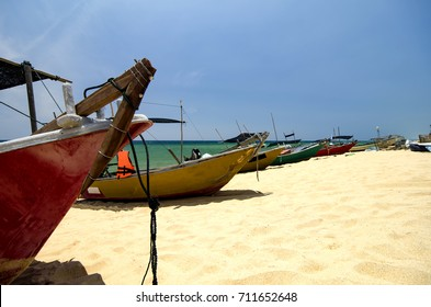 Beautiful scenery, traditional fisherman boats on sandy beach. bright sunny day and blue sky background
