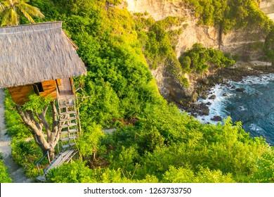 Beautiful scenery of Tree House (Rumah Pohon) , at Atuh Beach, Nusa Penida, Bali, Indonesia