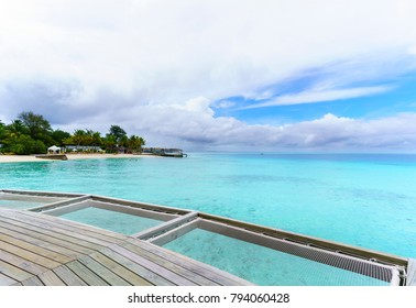 Beautiful scenery of tropical Maldives island , white clouds , blue sky and crystal clear turquoise sea