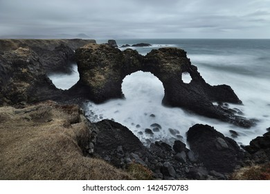 Beautiful scenery of Volcanic stone Arch Rock Gatklettur on the beach at Snaefellsnes Peninsula in Iceland is very popular for photographers and tourists. Attractions and travel concept.