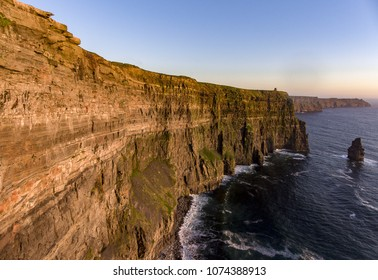 Beautiful Scenic Aerial drone view of Ireland Cliffs Of Moher in County Clare. Sunset over the Cliffs of Moher. Epic Irish rural countryside landscape along the wild atlantic way
