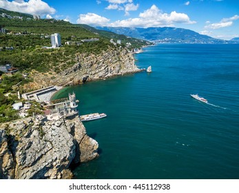 Beautiful scenic coastline with castle Swallow's Nest on a rock in Crimea, Russia. Swallow's Nest is a symbol and landmark of Crimea. Aerial panoramic view of the Black Sea coast of Crimea in summer.