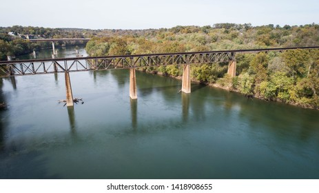 Beautiful Scenic Daytime View Aerial Drone Landscape Photography Rusted Steel Railroad Train Track Vintage Industrial Structure Crossing Historic Potomac River in Maryland, USA