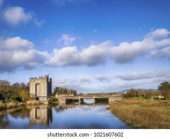 Beautiful scenic Irish Castle by a river. Bunratty Castle in County Clare, Ireland