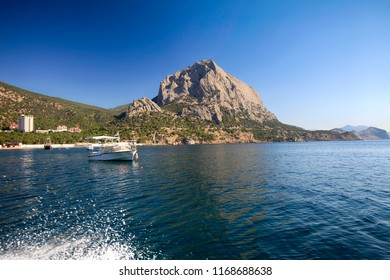 Beautiful scenic landscape of the Crimean coast, boat trip, view from the sea to the mountains