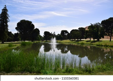 Beautiful scenic landscape of a lake during summer season at Hart Memorial Park, Bakersfield, CA. Scenic landscapes in Kern County.