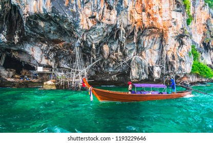 Beautiful scenic landscape of Viking cave with longtail boat for traveler, Maya bay Phi Phi island Krabi, Travel adventure Phuket Thailand Tourism destination scenery Asia Tourist summer vacation trip