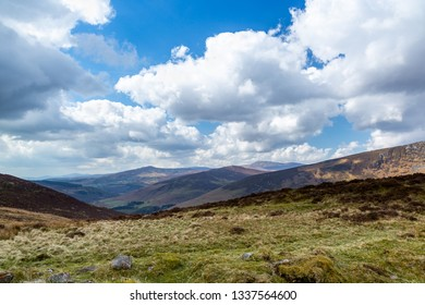 Beautiful scenic mountain landscape with clouds against the horizon in Wicklow mountains Ireland.