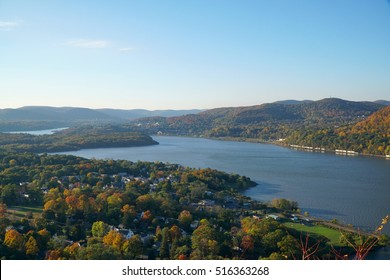 Beautiful scenic overlook view of Hudson River valley on an autumn morning, sunrise over the hills. Fall foliage on trees throughout the countryside.