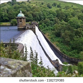 Beautiful scenic photo of a lake and white water flowing damn.  In the Welsh countryside.