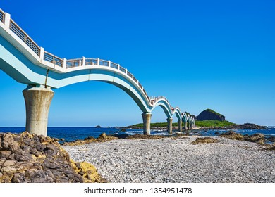 Beautiful scenic of Sanxiantai arch bridge with blue ocean with Three saint island in behind at Chenggong district in Taitung city, Taiwan.
