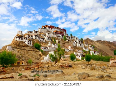 Beautiful scenic view - ancient Tiksey (Thiksey) Buddhist Monastery and traditional Tibetan houses against the background of blue sky - Leh district, Ladakh, Himalaya, Jammu & Kashmir, Northern India