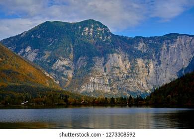 Beautiful scenic view in Austrian alps. Hallstatt mountain village at Hallstatt lake. Sunny day lake view from Hallstatt alps mountains. Location: resort village Hallstatt, Austria, Alps. Europe.