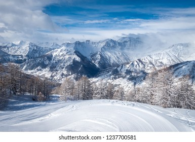 Beautiful scenic view of Bardonecchia, Piedmont, Italy, Italian Alps, covered in fresh snow after a snowfall against a crystal clear blue sky, snowy slopes, winter landscape. Photos with Snow