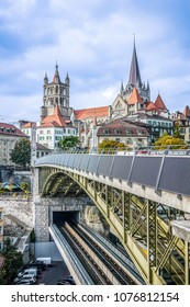 Beautiful scenic view of the Cathedral of Notre Dame of Lausanne and the Bessieres bridge in Lausanne, Switzerland.