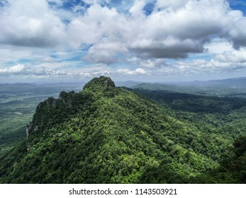 Beautiful scenic view of green jungle peak with amazing cloudy blue sky in Lampang province in thailand