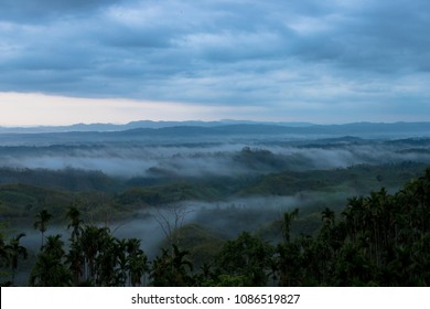 a beautiful scenic view of hills covered with fog in MIZORAM (time 4.45 AM)