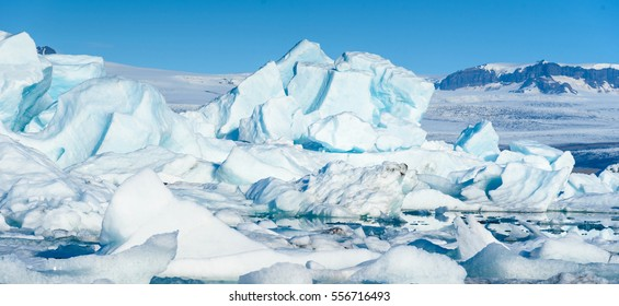 Beautiful Scenic view of icebergs in Jokulsarlon glacier lagoon, Iceland, selective focus, global warming concept