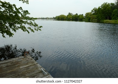 A beautiful scenic view of the lake from the edge of the dock to the horizon in the distance.