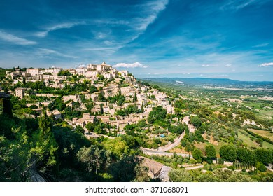 Beautiful scenic view of medieval hilltop village of Gordes in Provence, France. Blue sunny summer sky