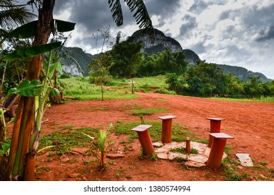 Beautiful scenic view on cuban valley in countryside of Vinales with mountains, palms and forest caribbean cuban rural life