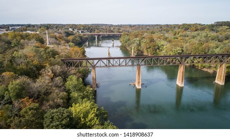 Beautiful Scenic View Outdoor Daytime Aerial Drone Landscape Photograph Old Rusty Steel Antique Vintage Railroad Trestle Train Track Crossing Historic Potomac River in Maryland, USA