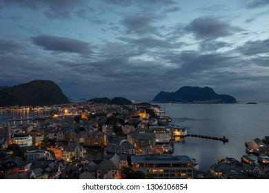 Beautiful scenic view over the city of Aalesund and the city lights during blue hour from Aksla. City, norway, aalesund, city lights, travel concept.