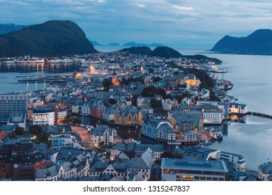 The beautiful scenic view over the city of aalesund in norway. Cities, city lights, island, fjords, scenery, landscape, nature, urban, northern, arctic concept.